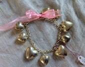 Silver charm bracelet, hearts