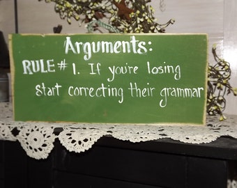 Wooden sign about arguments / wood sign
