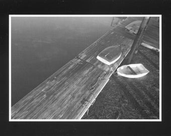 Black and white of dinghys on dock - photo card