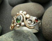green tourmaline & red garnet ring, handmade sterling silver band, with fiery gold colored brass details size 7 and 1/2