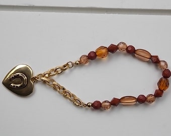 Vintage Stretch Bracelet with Gold Tone Heart with Horseshoe