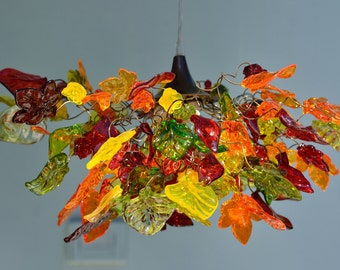 Lighting hanging chandeliers with warm color flowers and leaves , orange, red, yellow and green color.