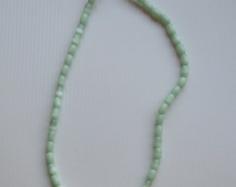 Strand of Light Green Oval Cats Eye Beads, apprx 7x5 mm