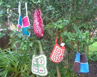Small crocheted tote bags.