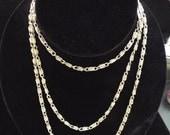 long, silver, wrap chain