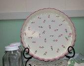 Deep ceramic dish with pink buds