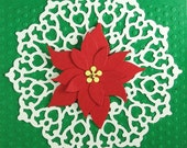 Christmas Card with a Lace Backgoround and  Red Poinsettia