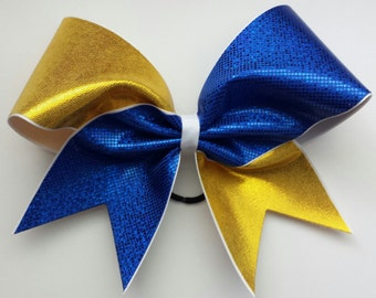 Royal blue and gold cheer bow. Ask about bulk discounts, color and mascot options.