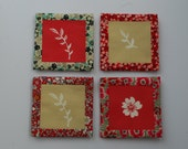 A set of four fabric coasters with tray.