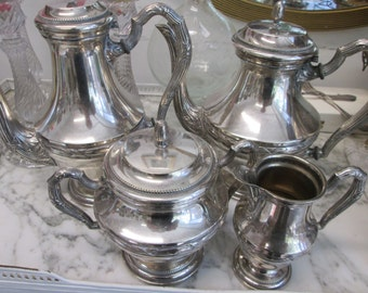 Beautiful set of 4 silver metal parts. Very deco. Very classy