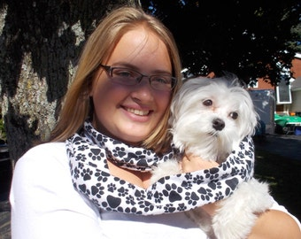 "Flannel white with black paw prints  infinity scarf.  Approx 5"" x 72"".  Great light weight scarf to add color  to your outfit."