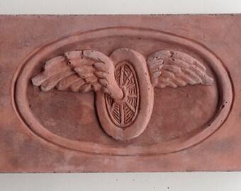 winged wheel brick