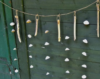 Sea shell & driftwood garland wallhanging for seaside cottage or beach hut. Ideal for sea lovers or anyone interested in the sea.