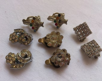 four pairs of vintage rhinestone clip on earrings