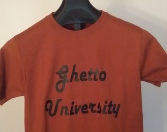 Ghetto University T shirt Size small brunt orange in color Fruit of the Loom