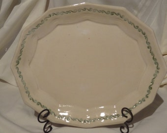 A great platter for the holidays!  White with green stamped decoration around the edge.