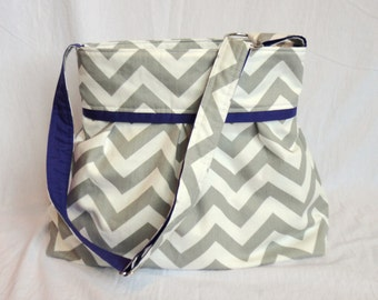 Pleated Diaper Bag large in gray chevron and purple lining.  Adjustabe strap with elastic bottle pockets and option of zipper