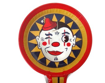 Vintage T Cohn Halloween noisemaker, smiling clown face, 1950s