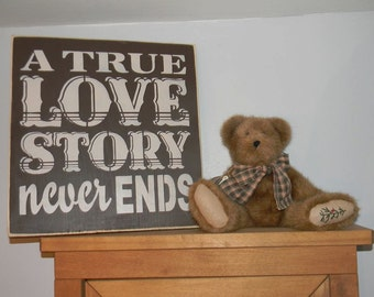 A True Love Story Never Ends sign