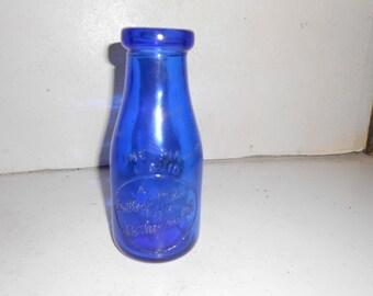 One pint blue milk bottle