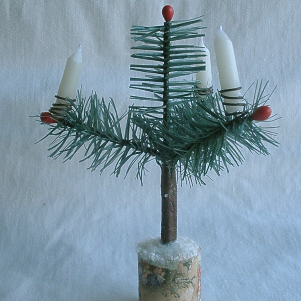 "Cedar three branch feather tree, 6"" inches tall w/ candles. It comes in white, or a mossy green color. (see other listings)."