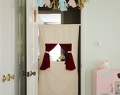 handmade doorway puppet theater, velvet curtain, kid playroom