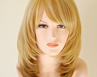 Ombre blonde mix layer cut. Everyday wear on the go wig.