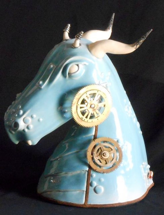 """Steampunk sculpture: """"Zomok""""  A Dragon who rules over storms and bad weather."""
