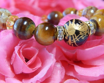 Good Luck and Protection. Round Tiger Eye Gemstone Bracelet with Dragon Bead.