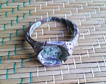 Antique ring. Bronze. Patina.