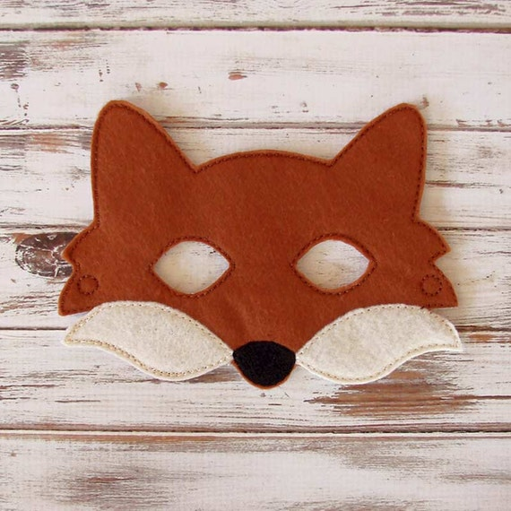 Free printable fox mask to color and craft into a wearable paper mask.