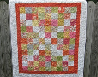 Small childs quilt, fun bright colors stippled quilting
