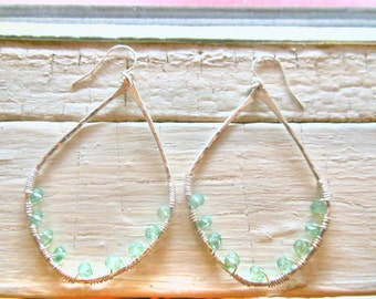 Oval sterling silver wide gauge hammered hoops with green amethyst