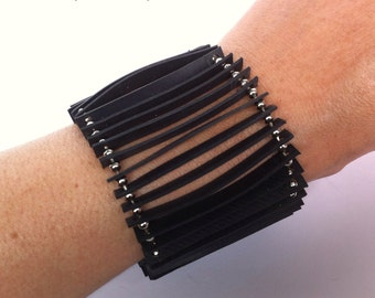 Bracelet made from inner tubes and ball chain.