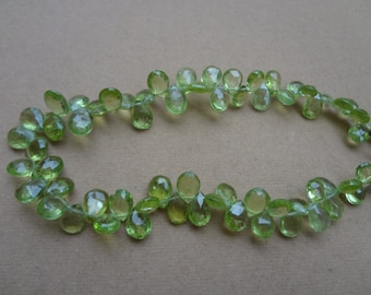 100 Pcs-  5 to 6 mm Peridot Briolette Faceted Pears -AAA Quality