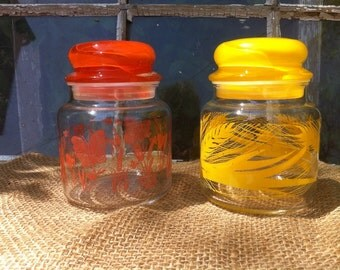 Retro Glass Apothocary Jars from the 1970's Set of Two in Orange and Yellow.