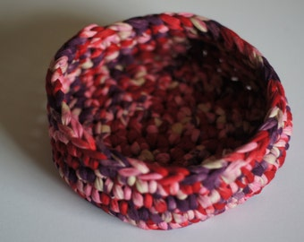 Colourful crochet bowl made using recycled textile yarn