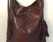 Beautiful soft dark brown leather handbag.