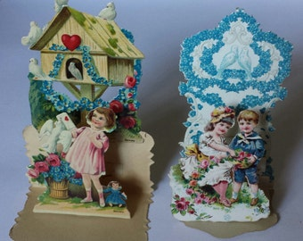 2 vintage stand-up Valentines, made in Germany, embossed designs, with tabs to allow them to open and stand in 3-D
