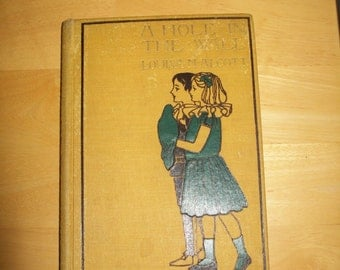 Antique 1899 Edition of A Hole in The Wall by Louisa M. Alcott and illustrated by Amy M. Sacker