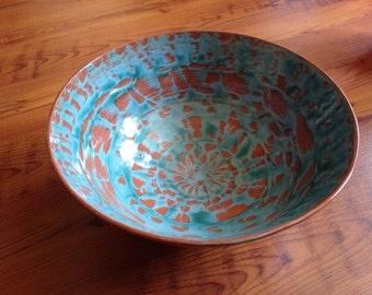 """10"""" Terracotta, slip painted bowl."""