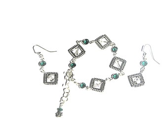 Antique tierra cast silver bracelet  with swarovski crystals and matching earrings.