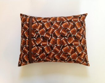 Football Gridiron Pillow with brown grosgrain and black ric rac.