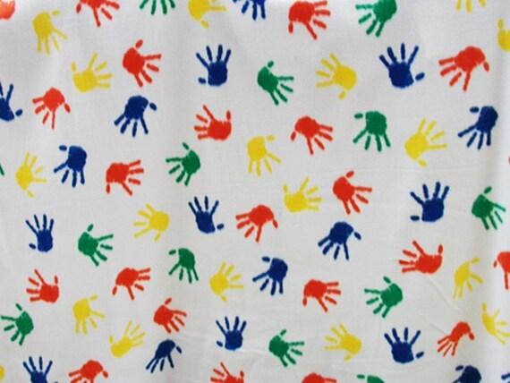 On salemulti colored hand prints fleece by reneeschoicefabrics for Fleece fabric childrens prints