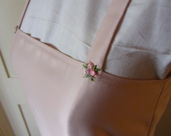 1920's style pink satin slip with side pleat detail.