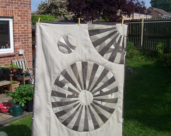 Wall hanging or small lap quilt, brown and beige, circles design, made from upcycled sheeting and new fine wool suiting fabric