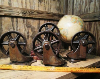 "Vintage Industrial BASSICK Swivel Cast Iron Large Caster Set of Four Metal Casters 10"" Tall 25.5 Pounds Each"