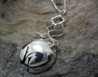 Forged and crafted handmade sterling silver pendant
