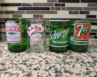 Four Vintage soda bottle juice glasses.