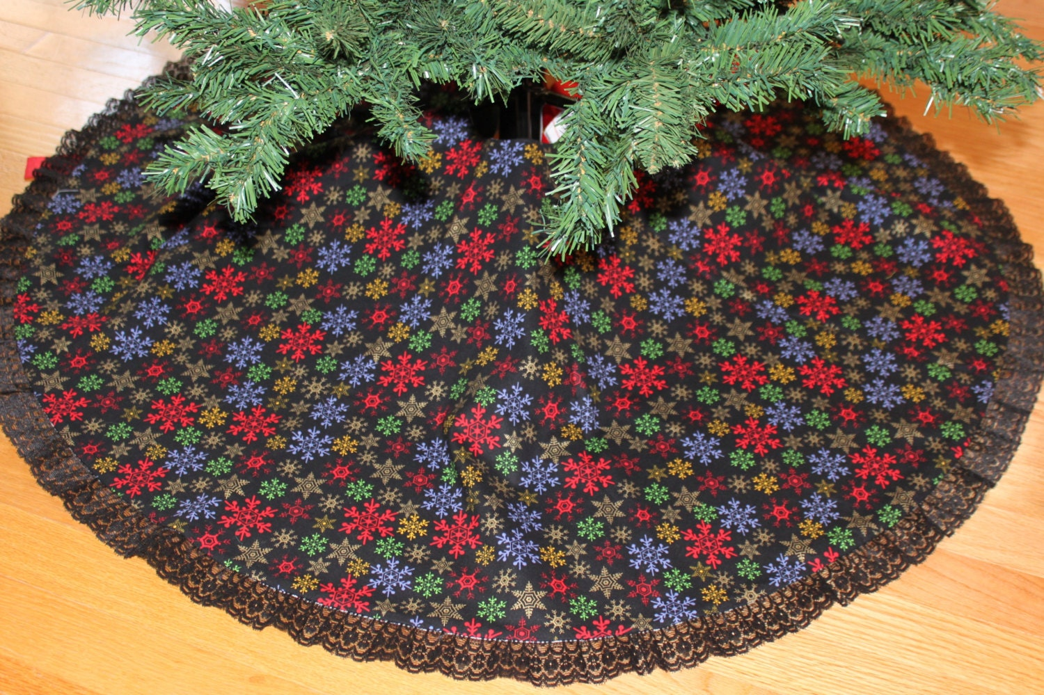 Christmas tree skirt handmade in multicolored snowflakes